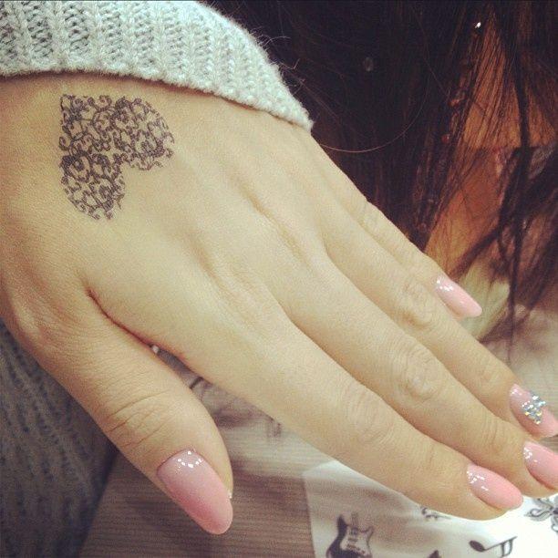 beautiful tattoo placement ornamental heart