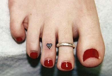 beautiful tattoo placement tiny heart on toe