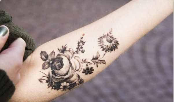 black blossoms tattoo on arm