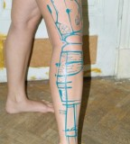 blue ink tattoo abstract leg work