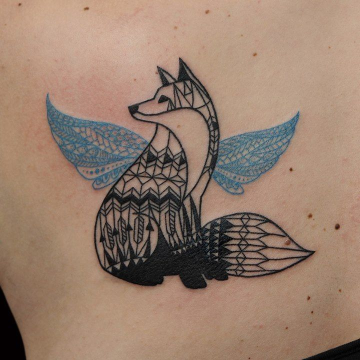 blue ink tattoo black fox with blue wings