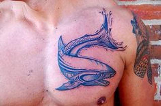 blue ink tattoo shark on chest