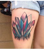 crystal tattoo on upper thigh