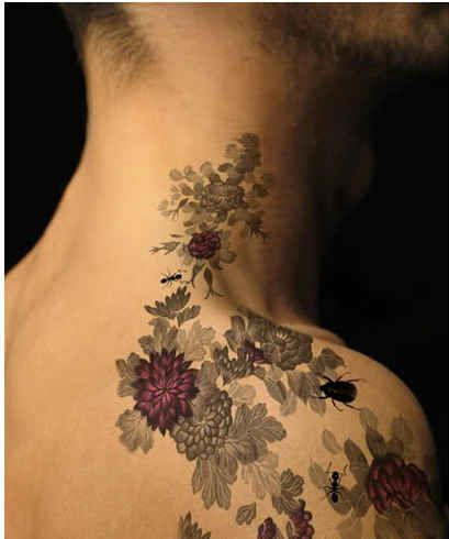 flowers and bugs neck and shoulder tattoo