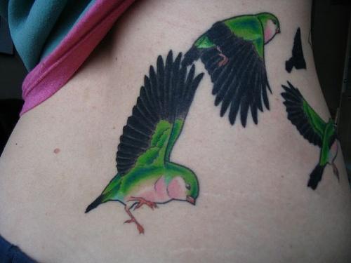 green tattoo flying birds