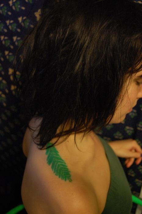 green tattoo redwood leaf on shoulder