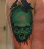 green tattoo skull and birds