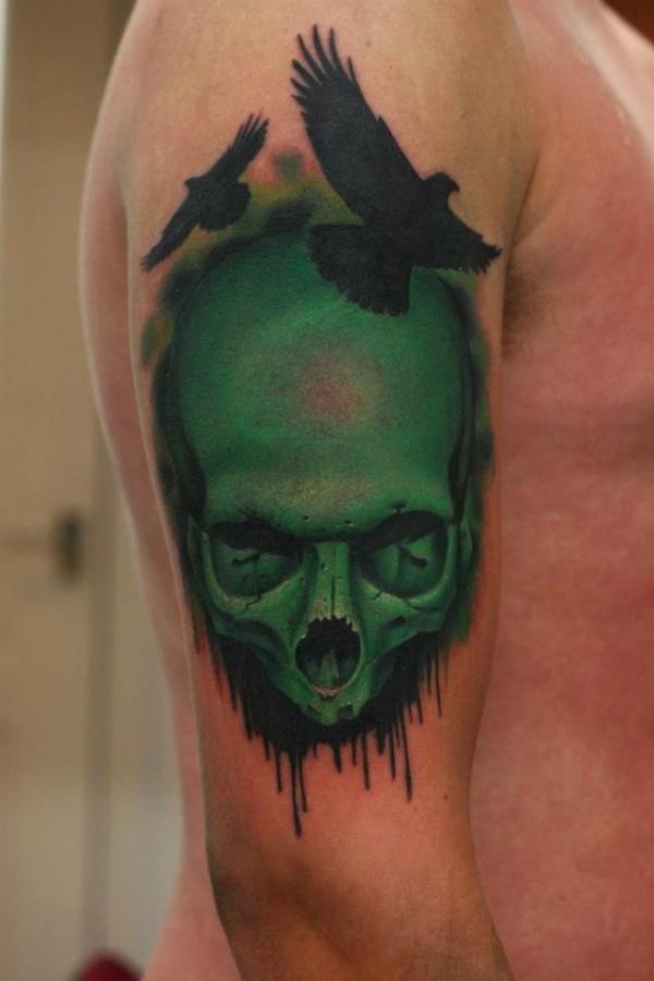 green tattoo skull and birds