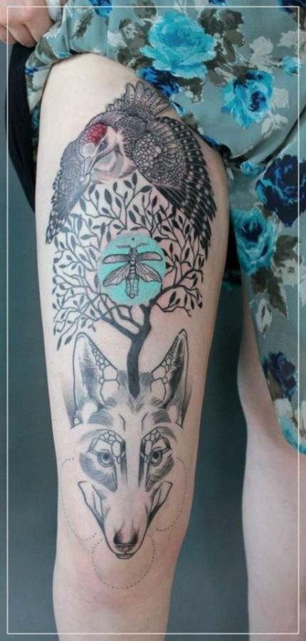 jessica mach tattoo bird tree and wolf composition on leg