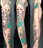 jessica mach tattoo black and green arm sleeve