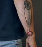 jessica mach tattoo feather on arm