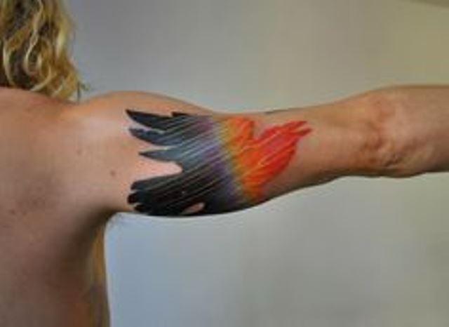 marcin aleksander surowiec tattoo bird on arm