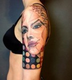 marie kraus tattoo upper arm sleeve with woman's face