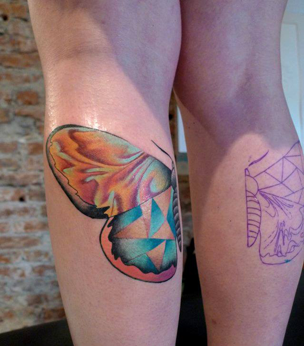 mariusz trubisz butterfly leg tattoo