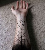 nature tattoo forest and birds blackwork on inside arm