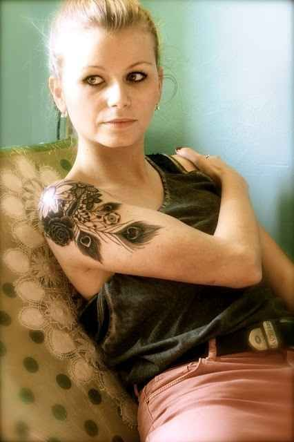 nature tattoo girl with peacock feather on shoulder