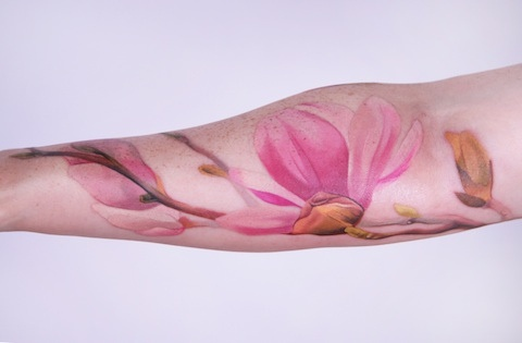 pastel watercolor flower tattoo on arm