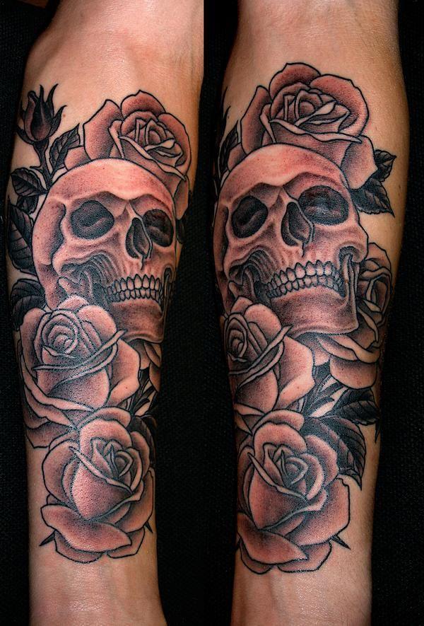rose tattoo with skulls