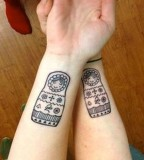 russian doll tattoo inside arms twin matryoshkas
