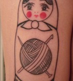 russian doll tattoo matryoshka with thread ball