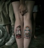 russian doll tattoo two matryoshkas on back legs