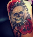skull tattoo with roses