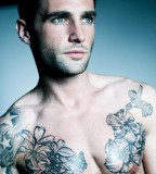 tattoos for men floral chest work