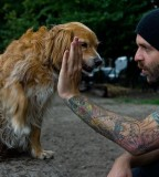 tattoos for men guy high fives dog