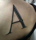 typographic back tattoo