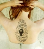 typographic back tattoo and days went by like paper in the wind