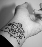 typographic wrist tattoo art music and love