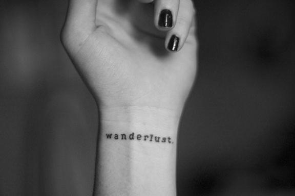 typographic wrist tattoo wanderlust