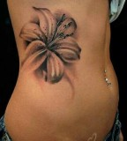 white and black flowers tattoo