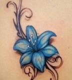 Amaizing blue flowers tattoo