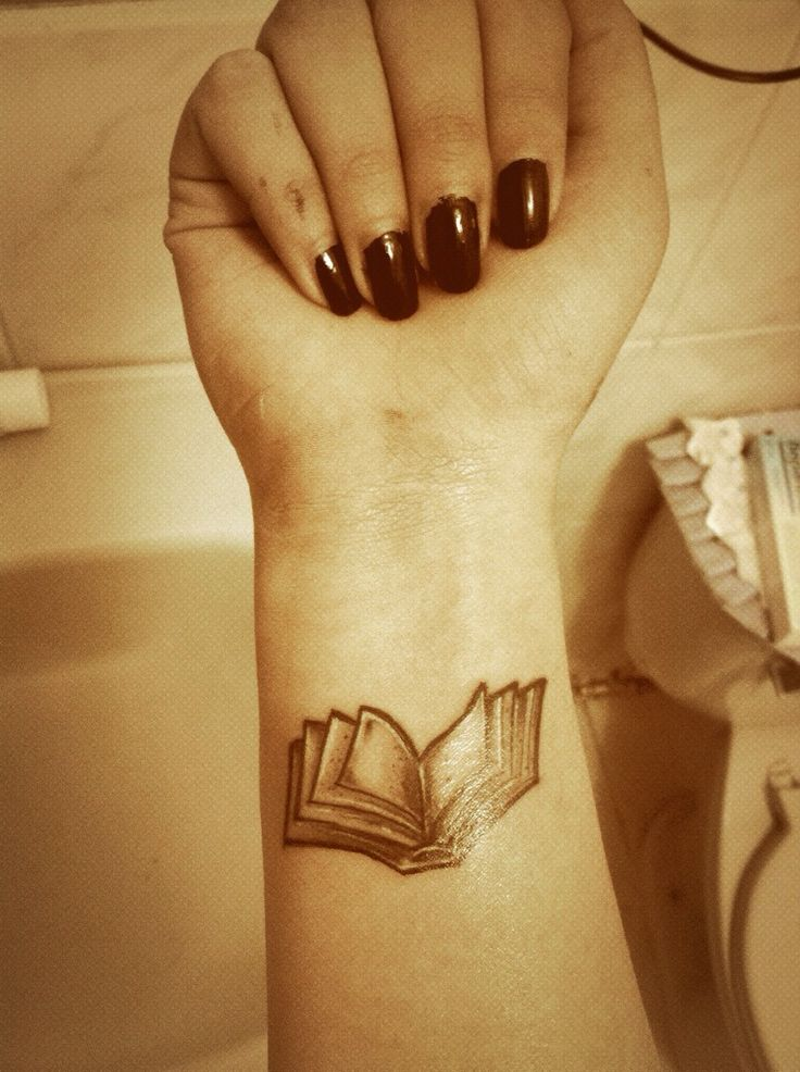 Arm book tattoo