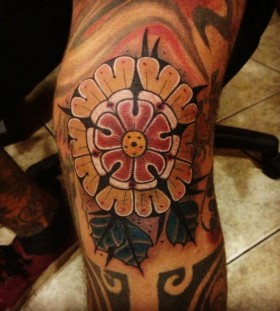 Awesome knee tattoo by Aivaras Lee