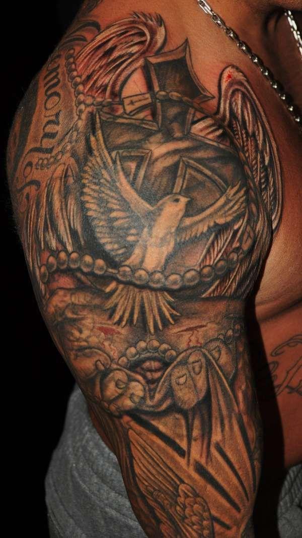 Bird religious tattoo