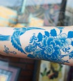 Birds and flowers blue tattoo