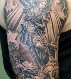 Black and white religious tattoo