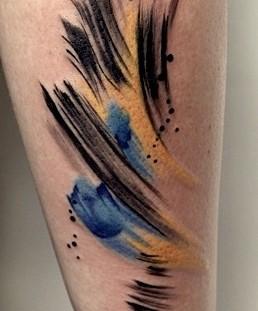 Black and yellow tattoo by Amanda Wachob