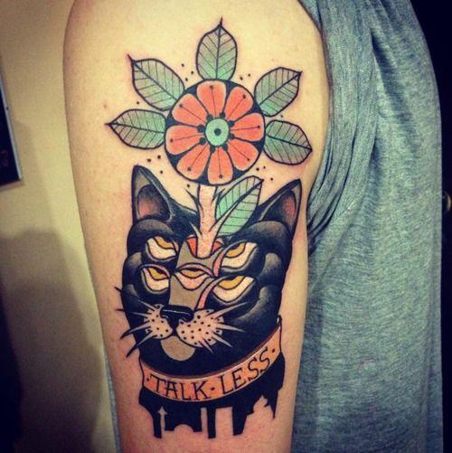 Black cat tattoo by Aivaras Lee