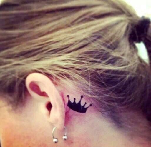 Black crown tattoo near ear