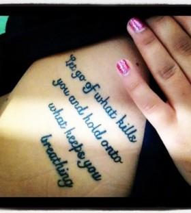 Black quotes tattoo