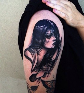 Black woman tattoo by Pari Corbitt