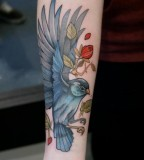 Blue bird and red rose tattoo