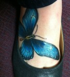 Blue bird tattoo on foot