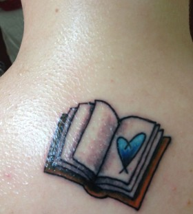 Blue heart and book tattoo