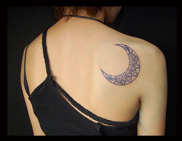 Blue moon tattoo on women back