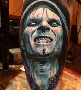Blue scary tattoo