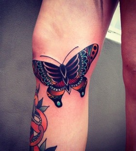 Butterfly tattoo by Kirk Jones